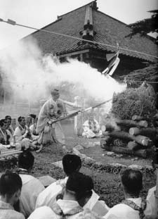 The Great Archbishop Miyage Tainen performing outside fire ceremony in front of the monastery of Mt.Sanjo
