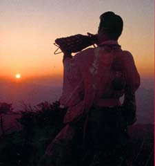 Yamabushi blowing conch shell on top of Mt.Sanjo(facing West)