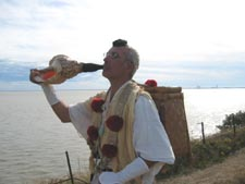 In France, Sylvain in yamabushi costume blowing inside a conch shell(Hora gai)